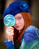 Youth with lolliepop in blue. Young girl with blue lollipop Royalty Free Stock Images