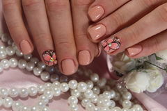 Youth manicure with butterfly. Here is presented one of the best manicure designs this year& x27;s Nail royalty free stock photography