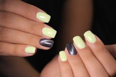Youth manicure design. Best nails, gel varnish royalty free stock photo