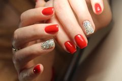 Youth manicure design red color. Youth manicure design gel varnish red color Stock Photo
