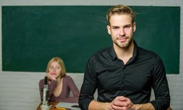 Youth mentoring. Man well groomed attractive teacher in front of classroom. Obsessed with knowledge. Teacher of her. Dreams. Handsome teacher. School and stock image
