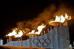 Youth Olympic Games 2012. INNSBRUCK, AUSTRIA - JANUARY 13 The olympic fire is burning during the opening ceremony at the Bergisel stadium on January 13, 2012 in Stock Image