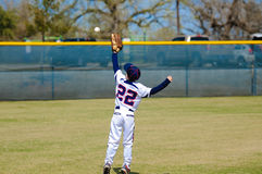 Youth outfielder catching ball Stock Photography