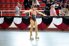 A youth participant performs at the figure skating competition. BARCELONA - APR 11: A youth participant performs at the figure skating competition at Pavello Stock Photography
