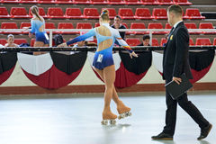 A youth participant performs at the figure skating competition. BARCELONA - APR 11: A youth participant performs at the figure skating competition at Pavello Royalty Free Stock Photos