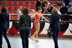 A youth participant performs at the figure skating competition Royalty Free Stock Image
