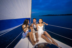 Youth party on a yacht. Stock Photos