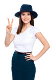Youth for peace. Studio portrait of an attractive young woman giving the peace sign isolated on white Royalty Free Stock Photo