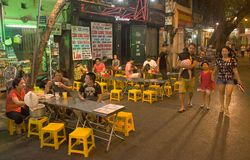 Youth people are eating at street food vendors in Hanoi`s. Unidentified youth people are eating at street food vendors in Hanoi s Old Quarter at night Stock Photo