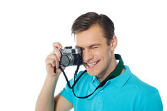 Youth photographer capturing images. Studio shot Royalty Free Stock Photos