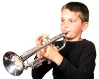 Youth Playing Trumpet. Child Playing Trumpet royalty free stock photography