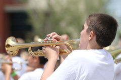 Youth plays horn in parade in small town America Royalty Free Stock Photography