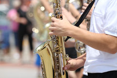 Youth plays sax in parade in small town America Stock Photo