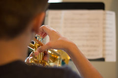 Youth Practicing Trumpet Royalty Free Stock Photos