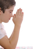 Youth praying. Shot of a youth praying on white Stock Photography