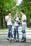 Youth on rollers in park Royalty Free Stock Images