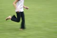 Youth running in grass Stock Photos