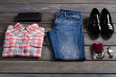 Youth set of men's clothing. Youth set of men's clothing on wooden boards Royalty Free Stock Photo