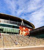 A youth sits on the steps to The Emirates Stadium Royalty Free Stock Images