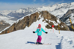 Youth skier on the piste Royalty Free Stock Photo