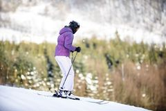 Youth skiing in the mountains stock photo