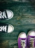 Youth sneakers on a gray wooden surface. Top view Stock Photo