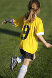 Youth Soccer. Young Girl Playing Soccer Stock Photos