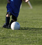 Youth Soccer. Boy kicking ball at youth soccer Royalty Free Stock Image