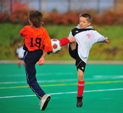 Youth soccer ball kick Royalty Free Stock Photo