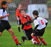 Youth soccer game. 10-31-2009 Hillsboro Or parks and rec youth soccer leauge.  FC Portland V Scapoose.  Scapoose player attempts to move the ball down the field Stock Image