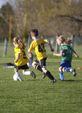 Youth Soccer Game. Kids plaing in a Youth Soccer Game Stock Images