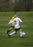 Youth Soccer Game. Two Children Competing at Youth Soccer Stock Photography