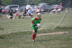 Youth Soccer Goalie In Action. On field during game Royalty Free Stock Images