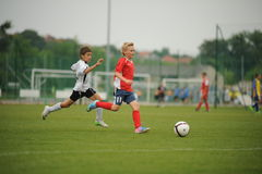 Youth soccer. KAPOSVAR, HUNGARY - JULY 15: Unidentified players in action at the VI. Youth Football Festival match - July 15, 2013 in Kaposvar, Hungary Stock Photography