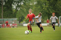 Youth soccer. KAPOSVAR, HUNGARY - JULY 15: Unidentified players in action at the VI. Youth Football Festival match - July 15, 2013 in Kaposvar, Hungary Stock Photos