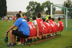 Youth soccer. KAPOSVAR, HUNGARY - JULY 15: Unidentified players sitting on the bench at the VI. Youth Football Festival match - July 15, 2013 in Kaposvar Royalty Free Stock Photos