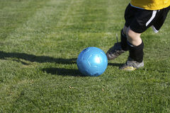 Youth Soccer (Kicking). Young Child Kicking a Goal with Copy Space Stock Photos