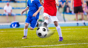 Youth soccer league.Training and football match between youth. Soccer teams. Running football players kicking ball Royalty Free Stock Photography