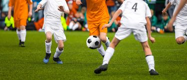 Youth Soccer Match. Young Footballers Kicking Soccer Game. Young Stock Image