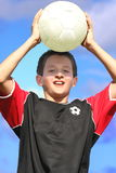 Youth soccer player. On  blue sky background Stock Photography