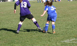 Youth Soccer Player in Action. On field during game Royalty Free Stock Photography