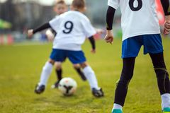 Youth Soccer Sport Background. Football Player Running with the ball. Football Soccer Background. Football Player Running with the Ball on the Pitch. Footballers Royalty Free Stock Image