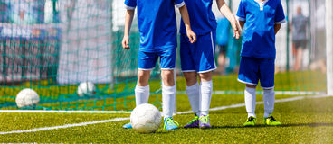 Youth Soccer Training Activities. Coaching Youth Soccer. Youth Football Practice, Training Session. Boys in Blue Shirts Practicing Soccer Royalty Free Stock Image
