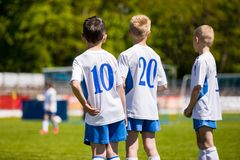 Youth Sport Soccer Team. Young Footballers as Substitute Players. Watching Football Tournament Match. Boys Kicking Football Soccer Game in the Background stock photos