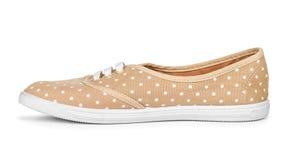 Youth stylish shoes beige white peas Royalty Free Stock Photos