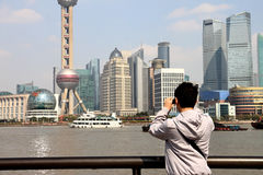 Youth taking pictures. At shanghai bund royalty free stock photo