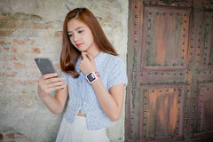 The Youth and technology. Amazed young woman with smartwatch usi Royalty Free Stock Photography