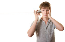 Youth With Tin Can Telephone Stock Photography