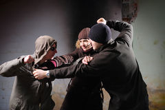 Youth violence. Young boys fighting for a girl Stock Images