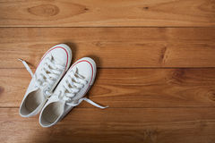 Youth white sneakers with white untied the laces Royalty Free Stock Photo